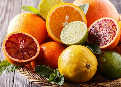 Assorted fresh citrus fruits.